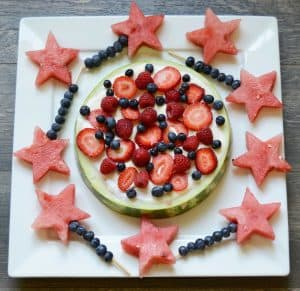 Fruit pizza made with watermelon, fruit dip, blueberries, raspberries and strawberries. Recipe for the 4th of July